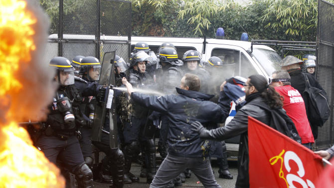 Goodyear employees scuffle with riot policemen during a demonstration against layoffs, in front of Goodyear headquarters in Rueil Malmaison, west of Paris, Thursday March 7, 2013. France has yet to hit bottom. The unemployment rate in Europe's second-largest economy rose again in the last quarter of last year to 10.6 percent, putting new pressure on President Francois Hollande's rollout a controversial labor-market reforms.(AP Photo/Remy de la Mauviniere)