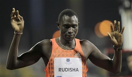 Kenya's David Rudisha celebrates winning the men's 800m at the IAAF Diamond League athletics meet, in Doha