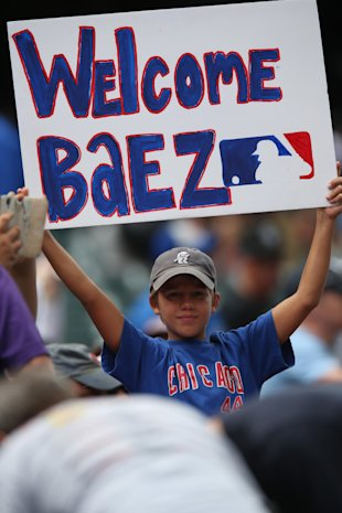 Even Cubs fans in Denver love Javier Baez. (AP)