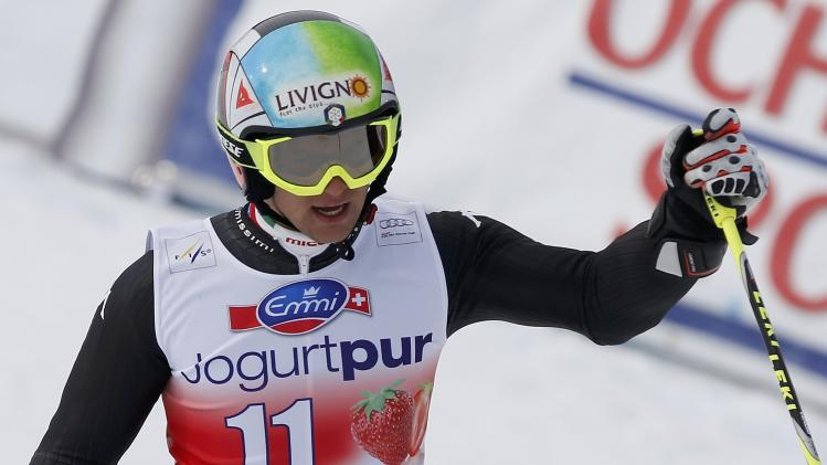 Nani of Italy reacts in the finish area during the first run of the men's giant slalom at the FIS Alpine Skiing World Cup Finals in Lenzerheide