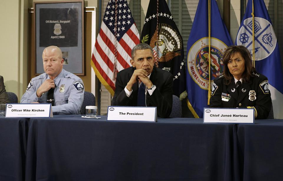 President Barack Obama, and others, listens during a roundtable discussion at the Minneapolis Police Department Special Operations, Monday, Feb. 4, 2013, in Minneapolis, Minn. From left are, Minneapolis Police  Officer Mike Kirchen, the president, and Minneapolis Police Chief Janee Harteau. (AP Photo/Pablo Martinez Monsivais)