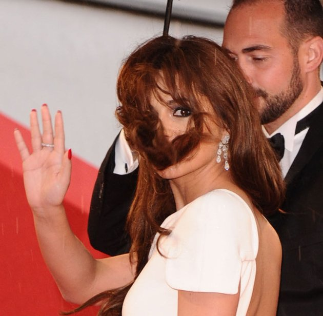 Celebrity photos: Cheryl Cole looked like an absolute goddess on the Cannes red carpet, but she did have one less than perfect moment when a gust of wind blew her hair all over her face. The star stil