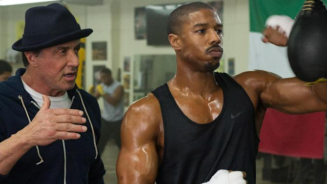 "This photo provided by Warner Bros. Pictures shows Michael B. Jordan, right, as Adonis Johnson and Sylvester Stallone as Rocky Balboa in Metro-Goldwyn-Mayer Pictures', Warner Bros. Pictures' and New Line Cinema's drama ""Creed,"" a Warner Bros. Pictures release. The movie opened in U.S. theaters on Nov. 25, 2015. (Barry Wetcher/Warner Bros. Pictures via AP)"