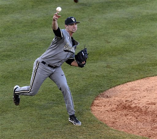 Vanderbilt's Tyler Beede throws to first for the out against Texas A&M during Game 14 of the Southeastern Conference NCAA college baseball tournament, Friday, May 24, 2013, at the Hoover Met in Hoover
