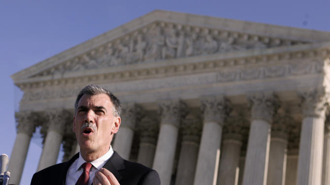 FILE - In a Jan. 7, 2008, file photo Attorney Donald Verrilli talks to media outside the Supreme Court after arguing against the use of a three drug cocktail for lethal injections in death penalty executions. Now Obama's top Supreme Court lawyer, Solicitor General Verilli was maligned for his performance in both the health care and Arizona immigration cases. Turns out, he largely prevailed in both cases, in which he also was in charge of producing the administration's written legal briefs. (AP Photo/Evan Vucci, File)