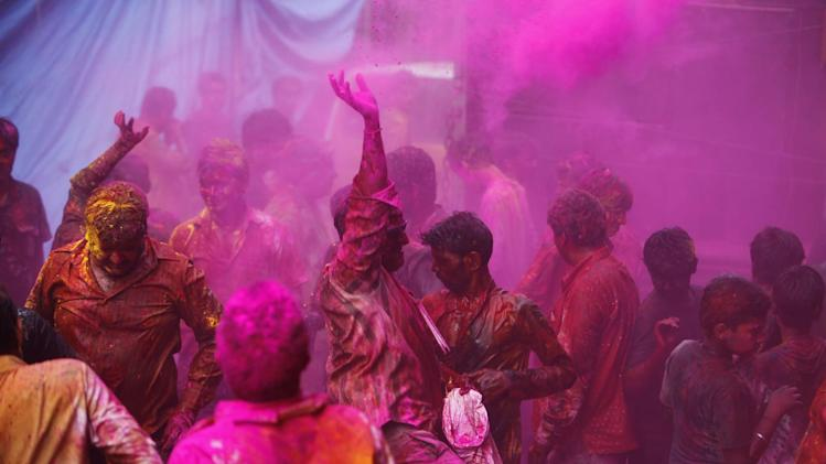 Hindu devotees play with colored powder during Holi festival celebrations in Hyderabad, India, Tuesday, March 26, 2013. Holi, the festival of colors celebrates the arrival of spring among other things. (AP Photo/Mahesh Kumar A.)