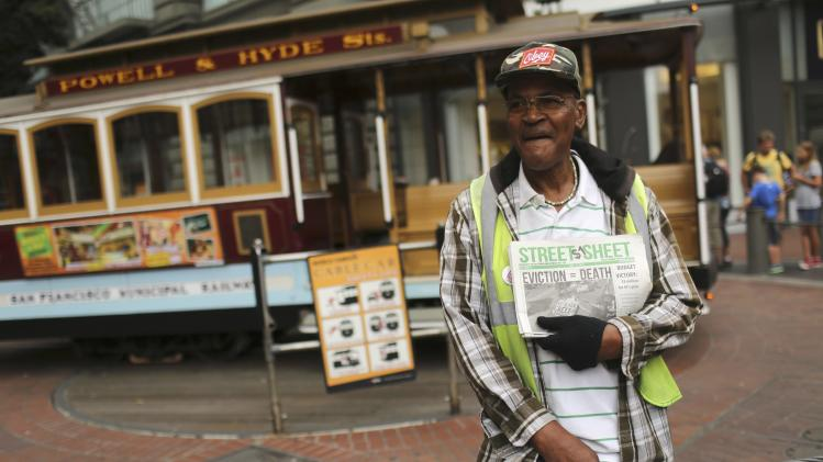 "Former municipal bus driver Butler who said he now helps the homeless, sells copies of the ""Street Sheet,"" a newspaper produced by the homeless, at the Powell Street BART and MUNI station in San Francisco"
