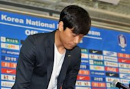 Arsenal striker Park Chu-Young bows his head during a press conference at the Korea Football Association in Seoul, on June 13. Park apologised for his controversial decision to delay military service in South Korea and vowed not to shirk his duty