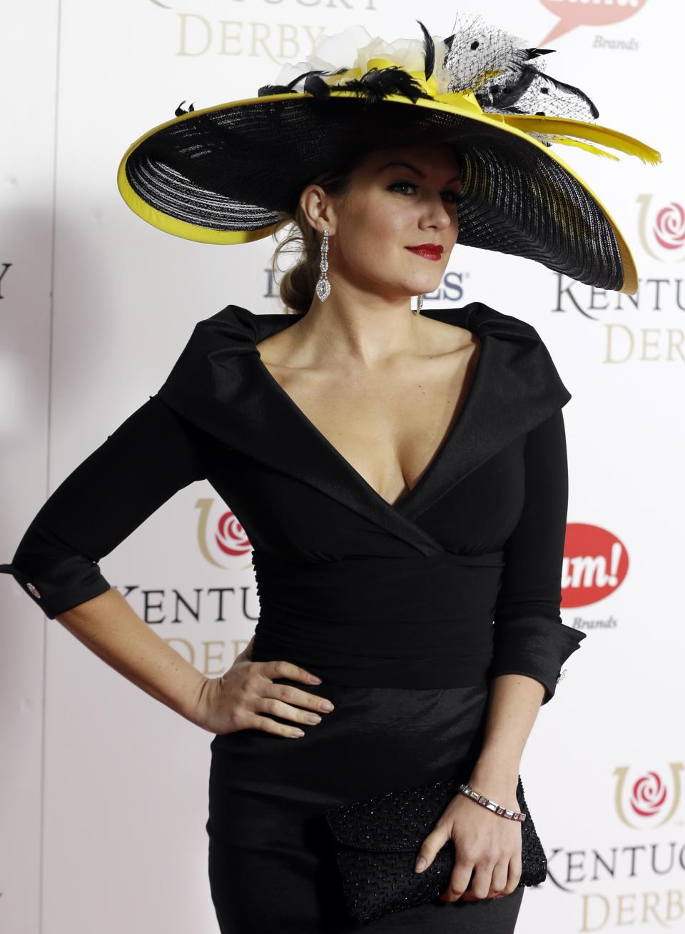 Miss American 2013 Mallory Hagan arrives to attend the 139th Kentucky Derby at Churchill Downs Saturday, May 4, 2013, in Louisville, Ky. (AP Photo/Darron Cummings)
