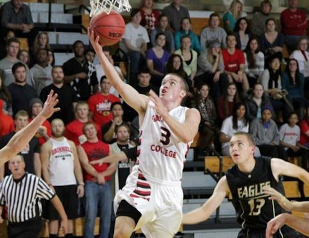 This image provided by Grinnell College shows Grinnell guard Jack Taylor (3) shooting one of 108 shots during Tuesday's Nov. 21, 2012 game against Faith Baptist Bible in Grinnell, Iowa. Taylor scored 138 points to shatter the NCAA scoring record in Division III. (AP Photo/Grinnell College, Cory Hall)