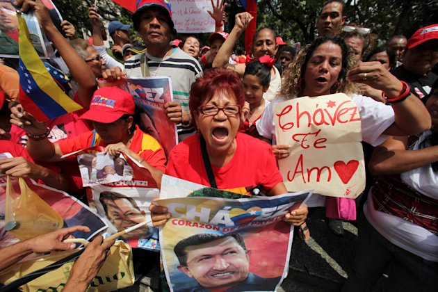 Supporters of Venezuela's President Hugo Chavez celebrate his return at Bolivar Square in Caracas, Venezuela, Monday, Feb. 18, 2013. Chavez returned to Venezuela early Monday after more than two month