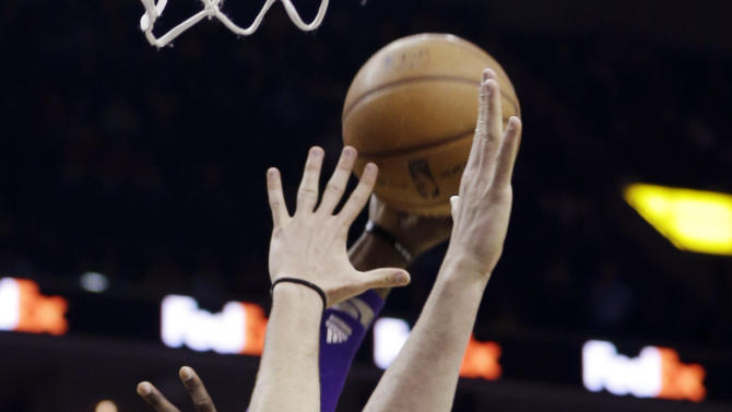 Los Angeles Lakers' Dwight Howard (12) goes to the basket over Memphis Grizzlies' Marc Gasol (33), of Spain, during the first half of an NBA basketball game in Memphis, Tenn., Wednesday, Jan. 23, 2013. (AP Photo/Daniel Johnston)