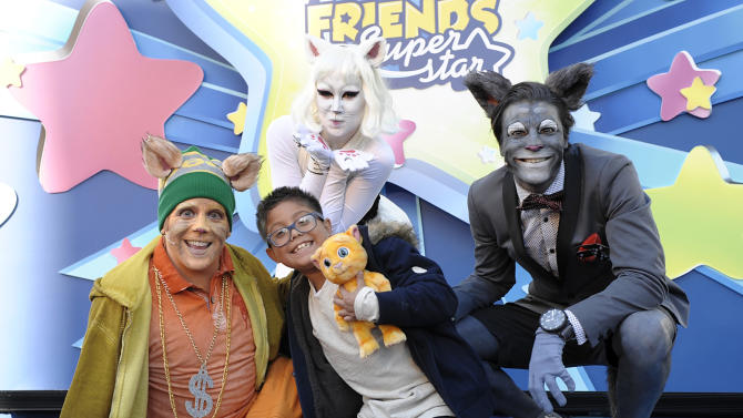 IMAGE DISTRIBUTED FOR TALKING FRIENDS SUPERSTAR - In this handout image released on Friday Dec. 21, 2012, from left, Talking Ginger, Talking Angela, and Talking Tom pose with a boy after winning a Talking Ginger Superstar toy at the Superstars Hit Hollywood performance at Hollywood and Highland Complex in Los Angeles. (Photo by Dan Steinberg for Talking Friends Superstar/Invision via AP Images)