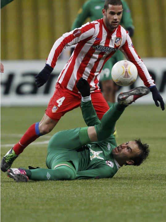 Rubin Kazan's Bebras Natcho fights for the ball with Atletico Madrid's Mario Suarez during their Europa League soccer match at the Luzhniki stadium in Moscow