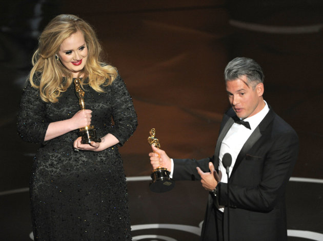 Singer Adele, left, and musician/producer Paul Epworth accept the award for best original song for &quot;Skyfall&quot; from &quot;Skyfall&quot; during the Oscars at the Dolby Theatre on Sunday Feb. 24, 2013, in Los Angeles. (Photo by Chris Pizzello/Invision/AP)