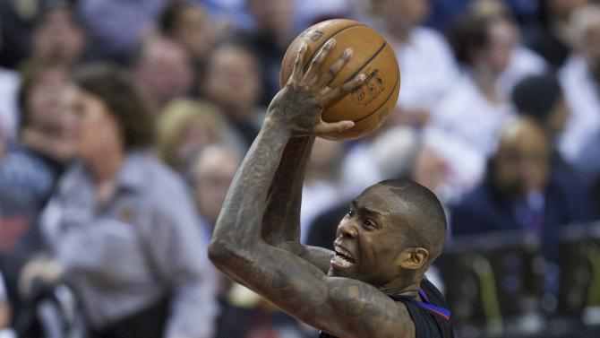 Los Angeles Clippers guard Jamal Crawford shoots in front of Portland Trail Blazers guard Gerald Henderson, right, during the first half of Game 6 of an NBA basketball first-round playoff series Friday, April 29, 2016, in Portland, Ore. (AP Photo/Craig Mitchelldyer)