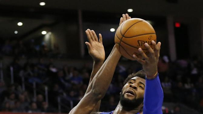 Detroit Pistons center Andre Drummond (0) is fouled by Oklahoma City Thunder forward Serge Ibaka as he shoots during the second quarter of an NBA basketball game in Oklahoma City, Friday, Nov. 27, 2015. (AP Photo/Sue Ogrocki)