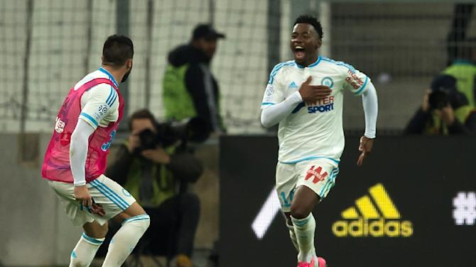 Marseille's midfielder Georges-Kevin Nkoudou (R) celebrates after scoring a goal against AS Monaco on November 29, 2015 at the Velodrome stadium in Marseille, southern France