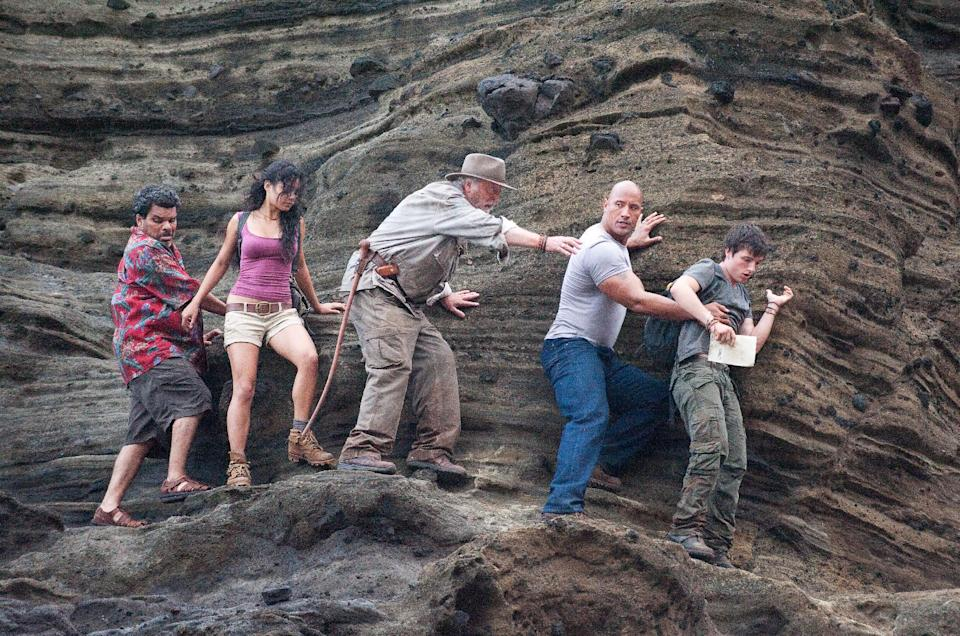 "In this image released by Warner Bros. Pictures, from left,  Luis Guzman, Vanessa Hudgens, Michael Caine, Dwayne Johnson and  Josh Hutcherson are shown in a scene from ""Journey 2: The Mysterious Island."" (AP Photo/Warner Bros. Pictures, Ron Phillips)"