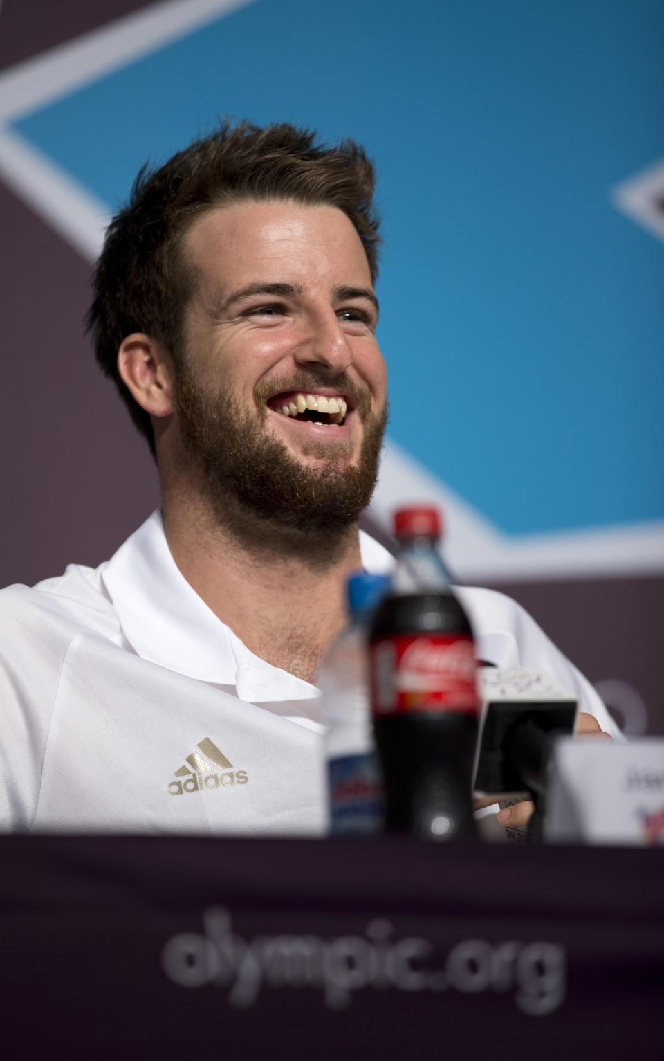 Australian swimmer James Magnussen laughs during a news conference at the Main Press Center ahead of the 2012 Summer Olympics, Monday, July 23, 2012, in London. (AP Photo/Matt Dunham)