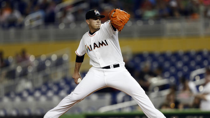 Miami Marlins starter Jose Fernandez pitches to the San Diego Padres during the first inning of a baseball game in Miami, Monday, July 1, 2013. (AP Photo/J Pat Carter)