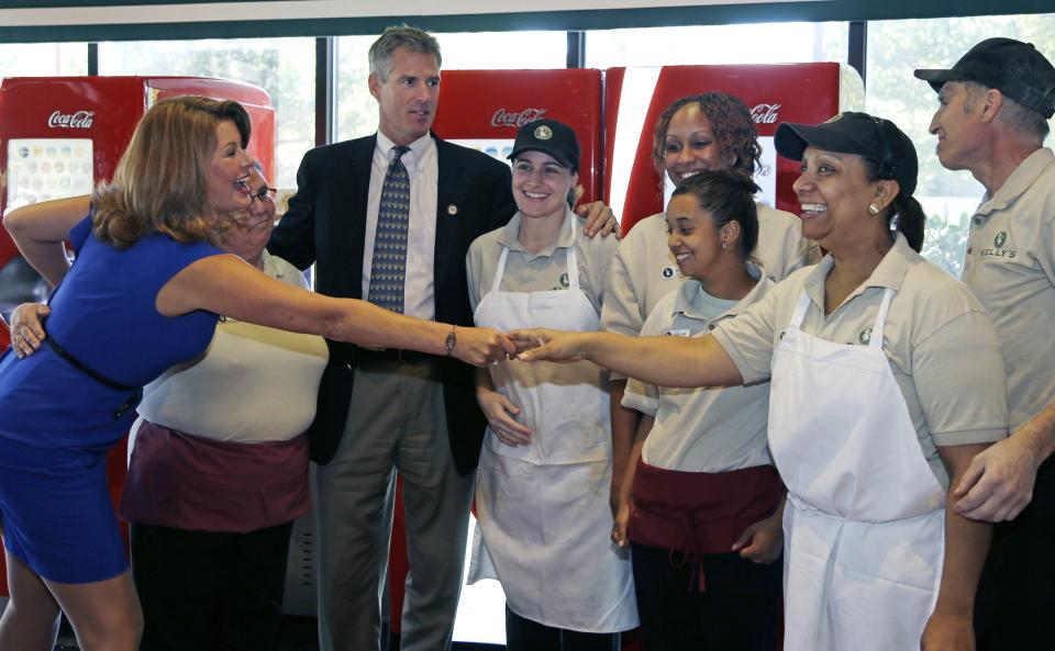 Republican incumbent U.S. Sen. Scott Brown, R-Mass., and his wife, Gail Huff, left, greet staff members as they campaign at Kelly's Roast Beef in Saugus, Mass.,Thursday, Sept. 27, 2012. (AP Photo/Elise Amendola)
