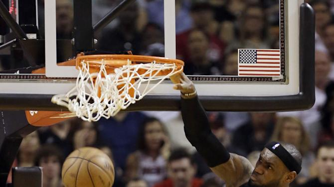 Miami Heat's LeBron James (6) dunks against the Indiana Pacers during the first half of an NBA basketball game in Miami, Sunday, March 10, 2013. (AP Photo/Alan Diaz)