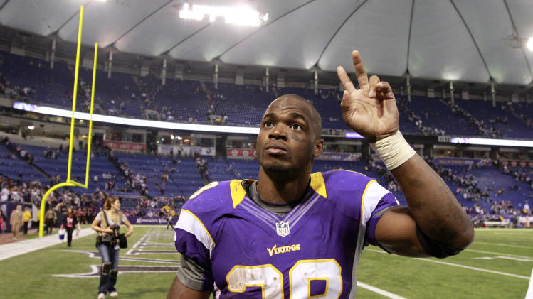 Minnesota Vikings running back Adrian Peterson walks off the field after an NFL football game against the Tennessee Titans, Sunday, Oct. 7, 2012, in Minneapolis. The Vikings won 30-7. (AP Photo/Genevieve Ross)