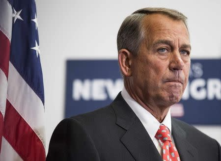 Speaker of the House Boehner listens as his fellow Republicans speak to the media after a conference meeting with House Republicans