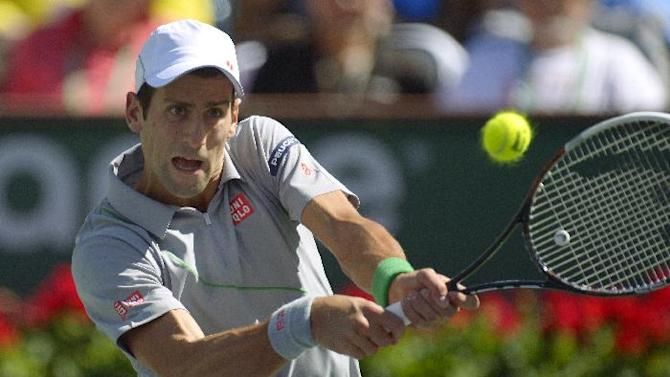 Novak Djokovic, of Serbia, hits to Julien Benneteau, of France, in their quarterfinal match at the BNP Paribas Open tennis tournament on Friday, March 14, 2014, in Indian Wells, Calif. (AP Photo/Mark J. Terrill)