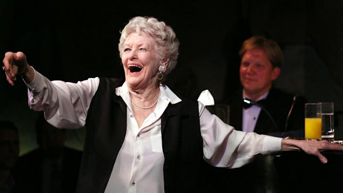 This April 2, 2013 image released by the O+M Company shows Elaine Stritch performing her final engagement at the Cafe Carlyle in New York with Rob Bowman at the piano. Stritch kicked off a final series of concerts to bid farewell to New York on Tuesday, refusing to be maudlin and instead weaving her typical brand of sass and feistiness. Stritch plans to retire to Birmingham, Mich. a suburb of Detroit, after seven decades in New York City. She ends her five-show farewell on Saturday.(AP Photo/The O+M Company, Walter McBride)