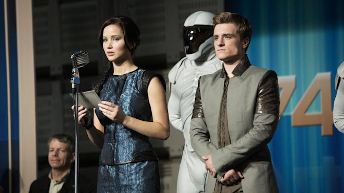 """This publicity photo released by Lionsgate shows Jennifer Lawrence, left, as Katniss Everdeen and Josh Hutcherson as Peeta Mellark in a scene from the film, """"The Hunger Games: Catching Fire."""" (AP Photo/Lionsgate, Murray Close)"""