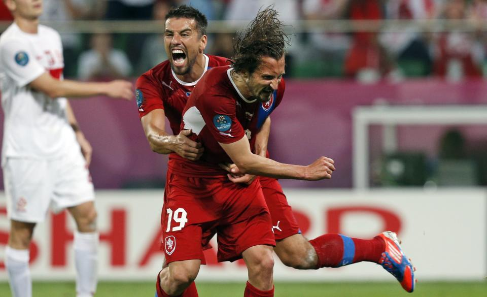 Czech Republic's Milan Baros celebrates teammate Petr Jiracek, right, scoring the opening goal during the Euro 2012 soccer championship Group A match between Czech Republic and Poland in Wroclaw, Poland, Saturday, June 16, 2012. (AP Photo/Czarek Sokolowski)