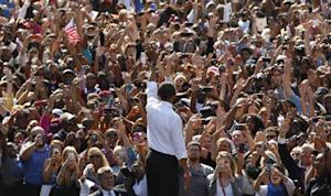 U.S. President Obama waves at a campaign rally in Richmond