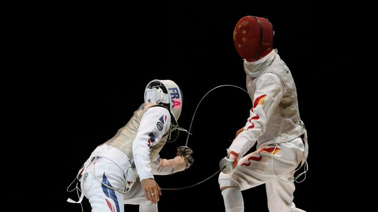 Le Pechoux of France competes against Lei of China in the men's team foil final match at the World Fencing Championships in Kazan
