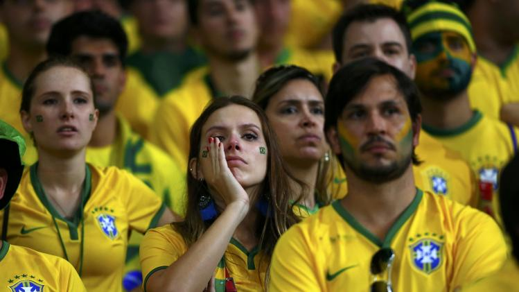 Brazil fans react during the 2014 World Cup semi-finals between Brazil and Germany at the Mineirao stadium