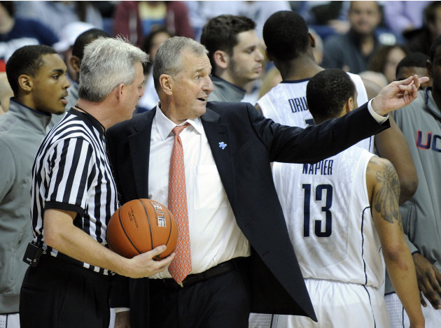 Connecticut coach Jim Calhoun speaks with an official during  the first half of an NCAA college basketball game against Pittsburgh, in Storrs, Conn., on Saturday, March 3, 2012. (AP Photo/Fred Beckham
