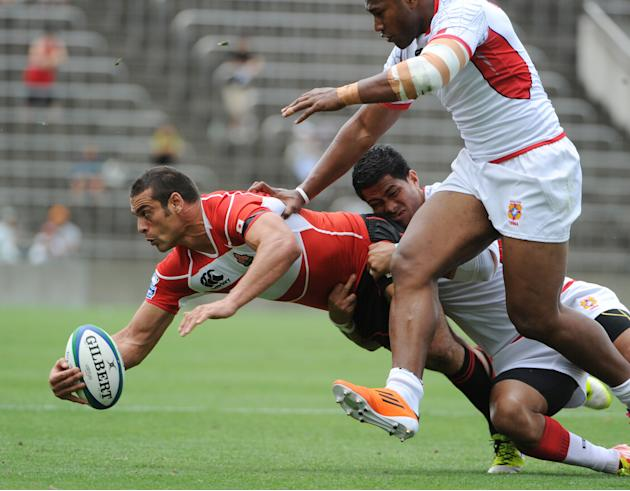 Japan's centre Ryan Nicholas is tackled