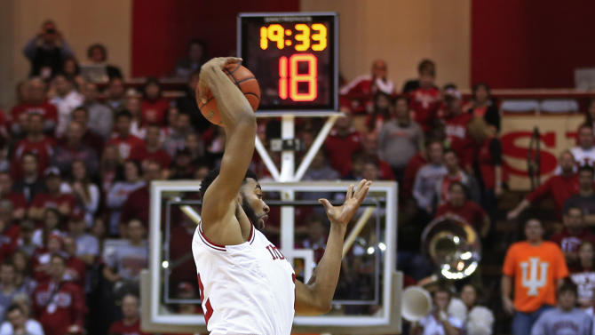 Indiana's Christian Watford intercepts a pass intended for Jacksonville's Kordario Fleming during the first half of an NCAA college basketball game Friday, Dec. 28, 2012, in Bloomington, Ind. (AP Photo/Darron Cummings)