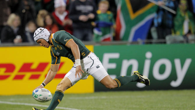 South Africa's Gio Aplon scores a try during their Rugby World Cup game against Namibia at North Harbour Stadium in Auckland, New Zealand, Thursday, Sept. 22, 2011. (AP Photo/Christophe Ena)