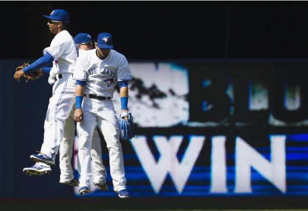 Jays' Gose, Rasmus, and Bautista celebrate defeating the Rays in their MLB American League baseball game in Toronto May