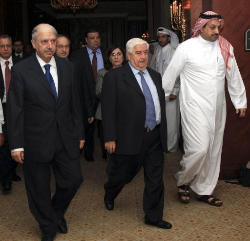 Syria's delegation leave after a meeting with the Arab League committee in Doha