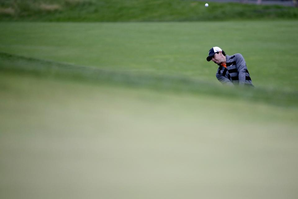 Rory McIlroy, of Northern Ireland, hits down the 15th hole during the first round of the U.S. Open golf tournament at Merion Golf Club, Friday, June 14, 2013, in Ardmore, Pa. (AP Photo/Morry Gash)