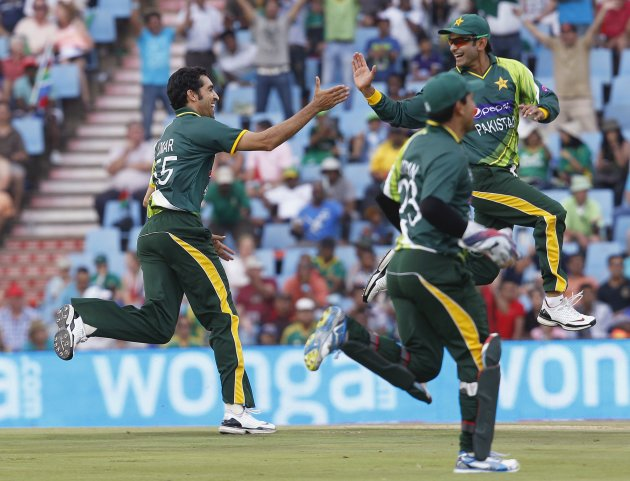 Pakistan cricket players celebrate the dismissal of South Africa's Behardien during the Twenty20 cricket match at Centurion in Pretoria