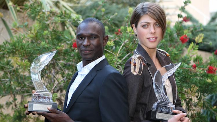 "Croatian high jumper Blanka Vlasic, right, and Kenyan middle distance runner David Rudisha, hold their International Athletic Foundation (IAF) ""Athlete of the Year Awards"", Sunday, Nov. 21, 2010, in Monaco. (AP PHOTO/Lionel Cironneau)"