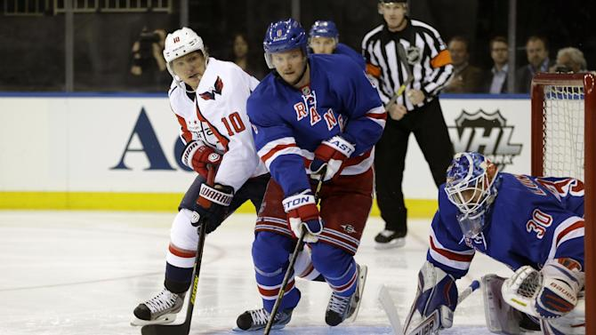 Washington Capitals left wing Martin Erat (10), of the Czech Republic, New York Rangers defenseman Anton Stralman (6), of Sweden, and goalie Henrik Lundqvist (30), also of Sweden, watch the puck as it sails past the crease in the first period of Game 3 of their first-round NHL hockey Stanley Cup playoff series in New York, Monday, May 6, 2013. (AP Photo/Kathy Willens)