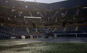 Arthur Ashe Stadium sits empty as rain falls on the court at the 2014 U.S. Open tennis tournament in New York