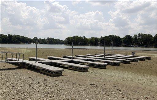 An empty dock sits on the bottom of a dry cove at Morse Reservoir in Noblesville, Ind., Monday, July 16, 2012. The reservoir is down nearly 6 feet from normal levels and being lowered 1 foot every fiv