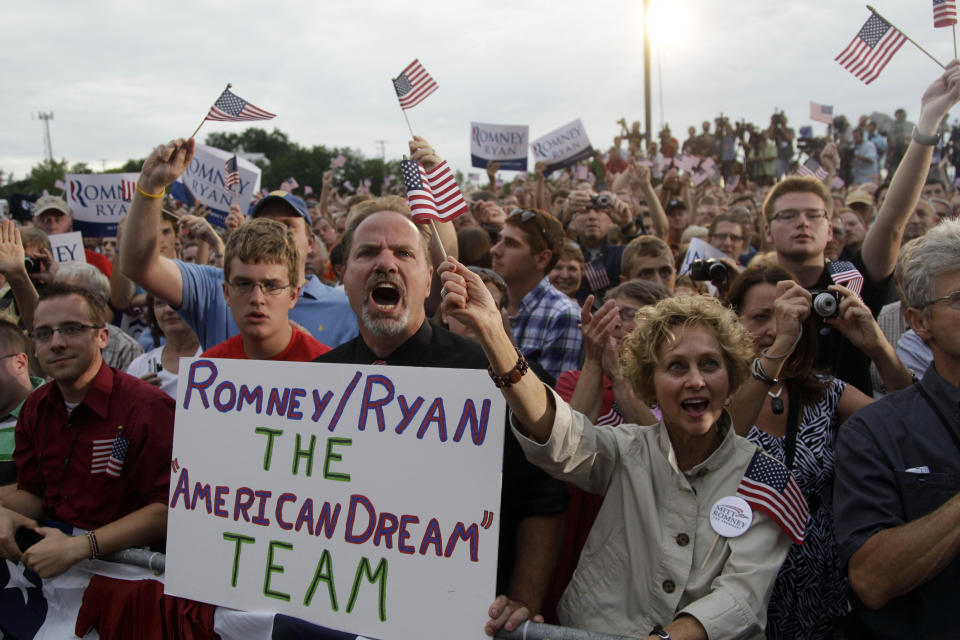 The crowd cheers Republican presidential candidate, former Massachusetts Gov. Mitt Romney, and vice presidential running mate Rep. Paul Ryan R-Wis., at a campaign event at the Waukesha county expo center, Sunday, Aug. 12, 2012 in Waukesha, Wis.  (AP Photo/Mary Altaffer)