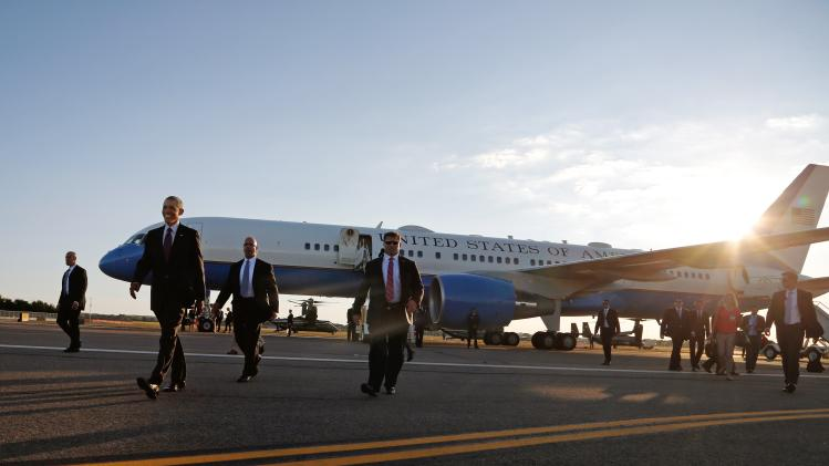 U.S. President Obama walks to greet onlookers as he arrives via Air Force One at T.F. Green Airport in Warwick, Rhode Island